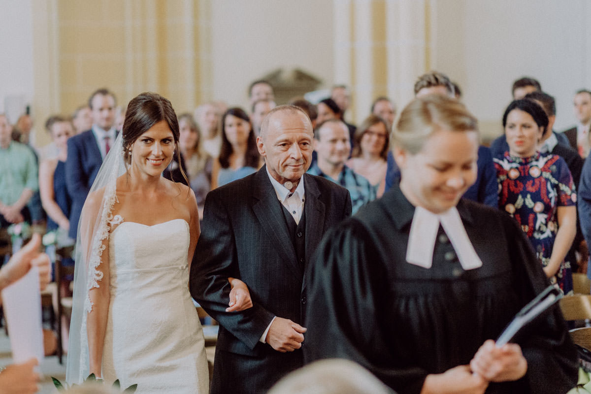 Bride and Dad walking into church